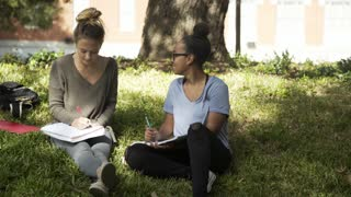 college girls studying and writing outside greets a friend 4k