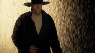 cowboy walking out of the rain