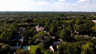crane down aerial suburban home establishing shot