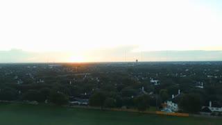 crane down aerial sunrise of a typical suburban neighborhood