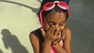 Cute Little Girl At A Water Park Wiping The Water From Her Eyes 4 K