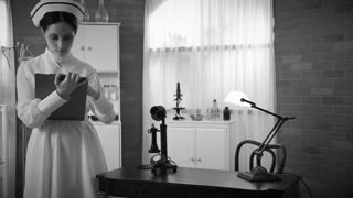 dolly 1930s nurse takes a phone call in the doctors office