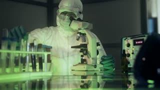 dolly laboratory scientist in hazmat looking at blood sample 4k