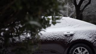 dolly right reveal snow packed on the top of a car 4k