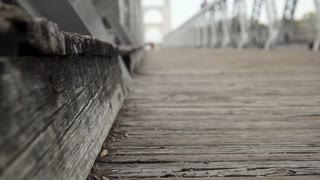 dolly shallow focus of deck of old suspension bridge waco texas 4k
