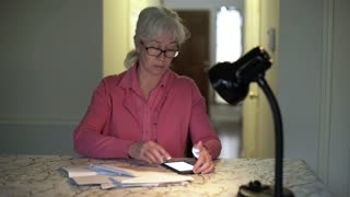 dolly woman paying bills online using smart phone 4k
