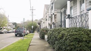 establishing shot of new orleans row of shotgun houses 4k
