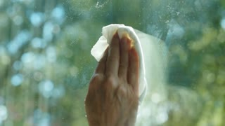 Extreme Closeup Of Woman Cleaning A Glass Window 4 K
