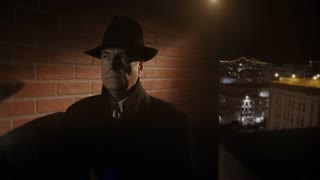 Film Noir Man On A Rooftop Looking Around 4 K