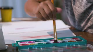 Focus On Water Color Paints While Little Girl Paints 4 K
