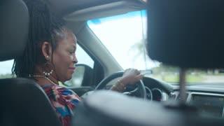 Friendly Ride Sharing Driver Talks to Customer
