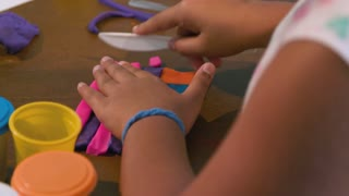 Girl Using Modeling Dough For A Craft Project 4 K