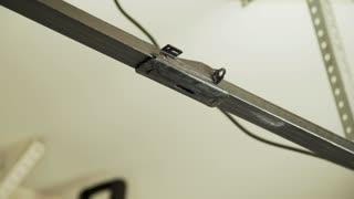 Homeowner replacing a belt on his home automatic garage door opener 4k