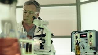 laboratory scientist putting sample under microscope 4k