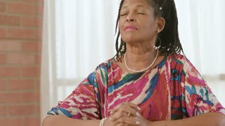 Lovely African American Woman Deep In Prayer
