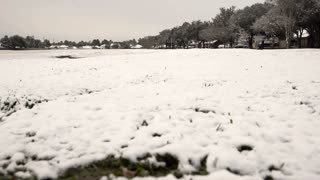 low angle dolly establishing shot of large snow covered field 4k