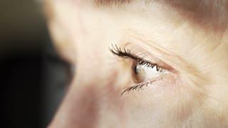 macro of the eyes of an older woman 4k