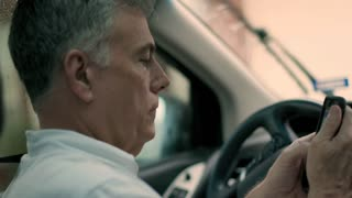 Male Ride Sharing Uber Driver Checks His App And Greets The Passenger 4 K