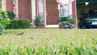man fertilizing his lawn slow motion