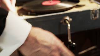 Man From 20 S Winding A Phonograph Focus On Hand 4 K