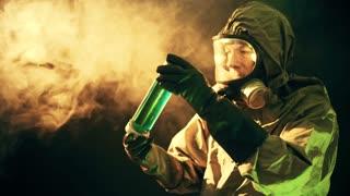 man in hazmat suit looking at a green liquid 4k
