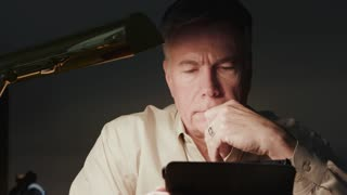 man looking at an ipad or tablet pc