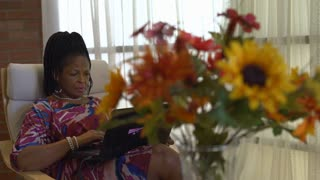 Mature African American Woman Shopping Online