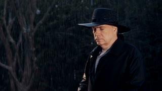 medium shot cowboy in a rain storm