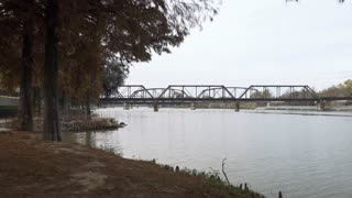 old rusted train bridges in waco texas on the brazos river 4k