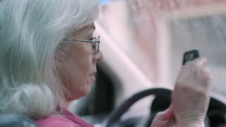 older woman uber taxi or ride sharing driver greets passenger 4k