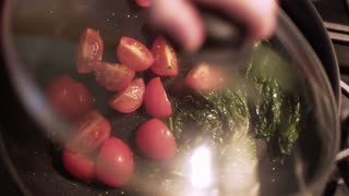 overhead shot of cook removing pan lid while cooking tomatoes 4k