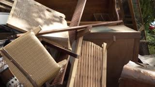 pan across flood damaged antique furniture after hurricane harvey 4k