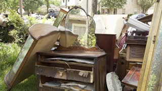 pan across flooded and discarded antique furniture after hurricane harvey 4k