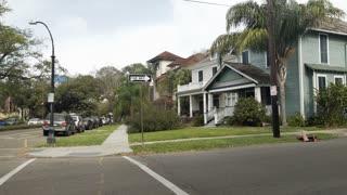 pan establishing shot of typical new orleans neighborhood homes 4k