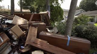 pan flood damaged furniture and debris after hurricane harvey 4k