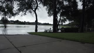 Pan From A Suburban Homeowners Driveway Showing The Flooded Streed After A Hurricane 4 K