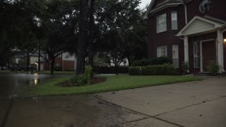 pan from suburban home to flooded street in Houston Texas 4k