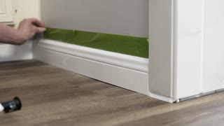 pulling painting tape from newly painted baseboard 4k