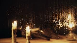 rack focus from rainy window to western scene inside