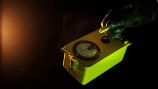 sci-fi scientist in a dark room checking green liquid with geiger counter 4k
