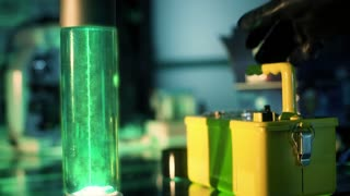 sci-fi scientist picks up geiger counter and checks glowing fluid 4k