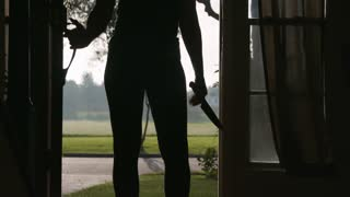 Silhouette Of A Woman Standing At A Door Holding A Large Knife 4 K