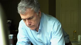 Slow Motion Somber Man Looking Up To Camera