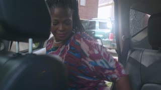 Smiling ride sharing customer gets into vehicle