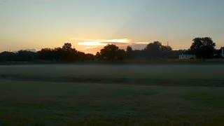 sunrise over a typical suburban neighborhood