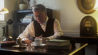 thirties businessman working on paperwork at his desk 4k