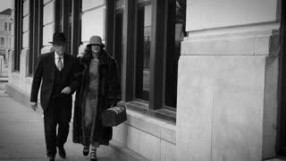 thirties man and woman walks past camera 4k
