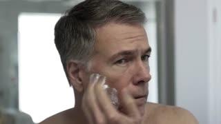 timelapse man looking in the mirror shaving 4k