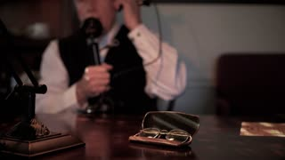 twenties businessman talking on the phone at his desk 4k