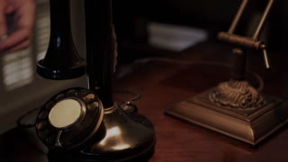 twenties man using a candle stick phone closeup 4k